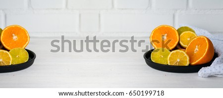 Shutterstock Citrus fruits - orange, lemon, lime on white wooden table. Copy space. Wide panoramic image.