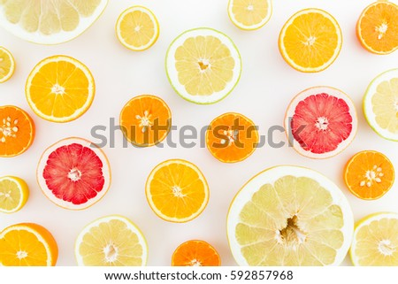 Citrus fruits pattern made of lemon, orange, grapefruit, sweetie and pomelo on white background. Flat lay, top view. Fruit's background #592857968