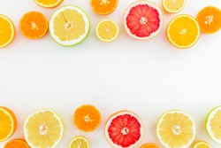 Citrus fruits pattern of lemon, orange and grapefruit on white background. Flat lay, top view.