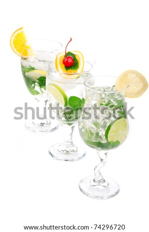 Citrus Mojito cocktails with light rum, vodka, gin, lime, spring of ...