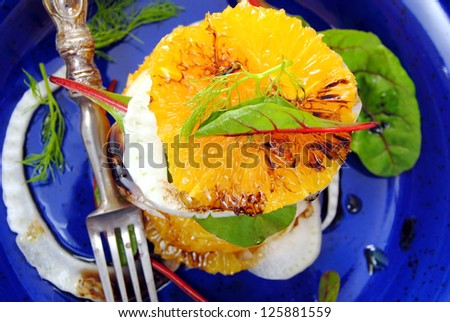 Citrus salad closeup.Oranges and fennel with herbs and balsamic vinegar.Vitamin salad.Healthy, light, raw food. Diet detox concept.Winter fruit salad.