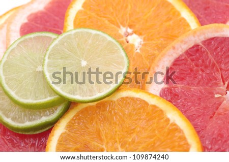Citrus slices background - orange, lime, grapefruit
