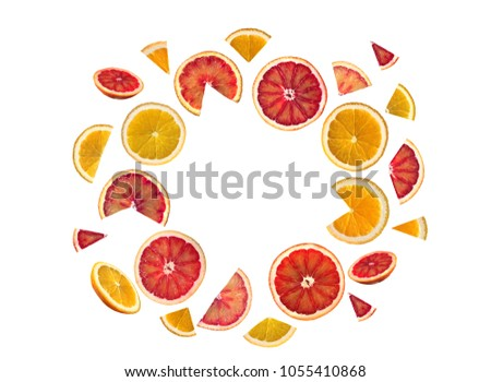 citrus slices lie in a circle on a white background #1055410868