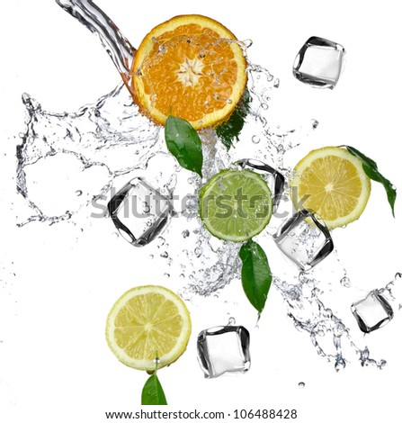 Citruses with splashing water and ice cubes