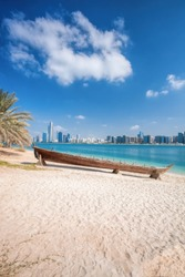 City Abu Dhabi with wooden boats in United Arab Emirates