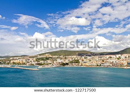 City and harbor at Kusadasi, bird island on the turkish coast of the Aegean sea