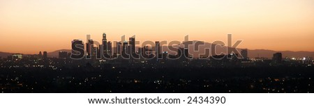 City at dawn with mountains behind