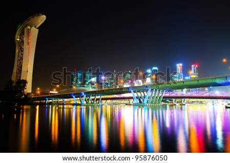 City at night in Singapore,  view of the bridge and the reflection of artificial light