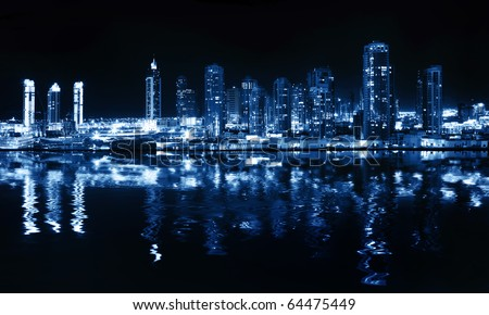 City at night, panoramic scene of downtown reflected in water, Dubai