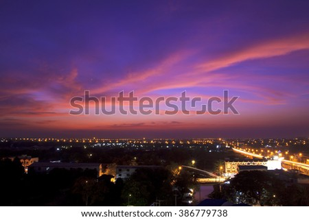 Stock Photo City at the sunset with twilight sky background landscape with long exposure car light and beautiful cloud