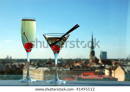 city background with fizz and martini