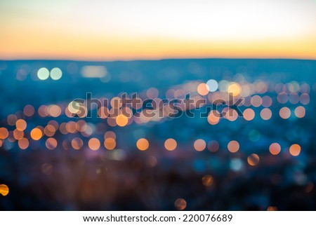 city blurring lights abstract circular bokeh on blue background with horizon, closeup