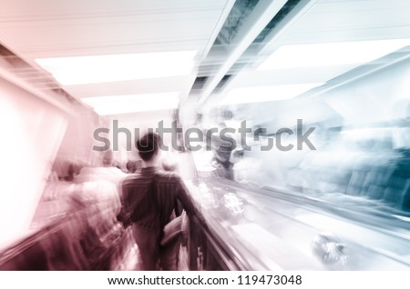 city business people on escalator abstract blur