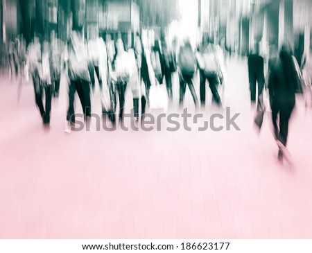 City business people walking in the commercial street, blurred motion background