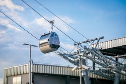 City cable car with panoramic views of the city. Modern cab with cable.