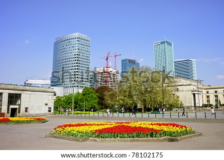 City center of Warsaw in Poland, square with flowerbed and modern architecture