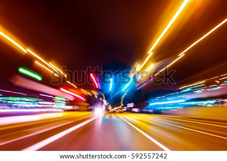 City colorful night lights perspective blurred by high speed of the car. A streak of light, trails. #592557242