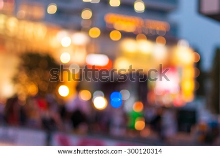 City commuters. Blurred image of people near shopping center. Unrecognizable faces, bleached effect