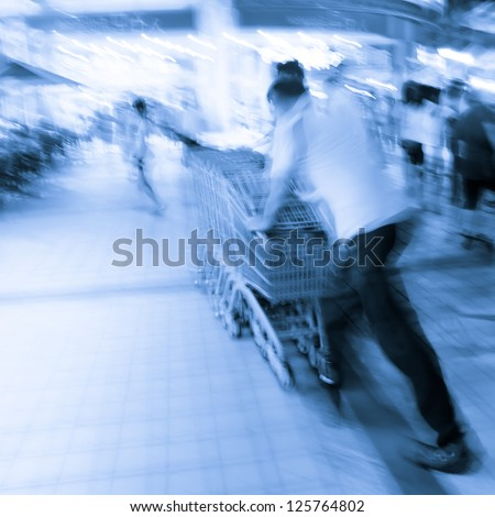 city crowd people with shopping cart blur motion - stock photo