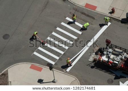 City employees striping crosswalk #1282174681