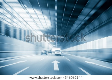 city expressway traffic with cars motion blur in a steel structure of sound insulation construction #346062944