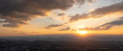 City from the viewpoint on top of the sunset behind mountain take a photo of Loei Thailand from Phu Bo Bit mountain peak