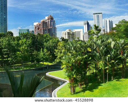 City gardens with skyscrapers and blue sky