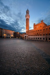 City Hall Bell Tower at Piazza del Campo in Siena Italy.