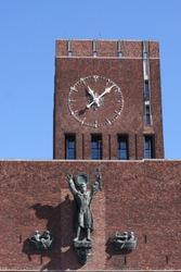 City Hall in Oslo with big vintage clock - Radhuset, Norway.