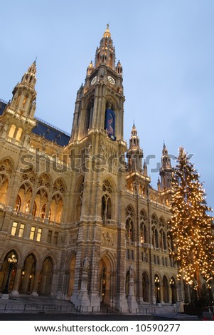 City hall in Vienna in the evening with big Christmas tree in front