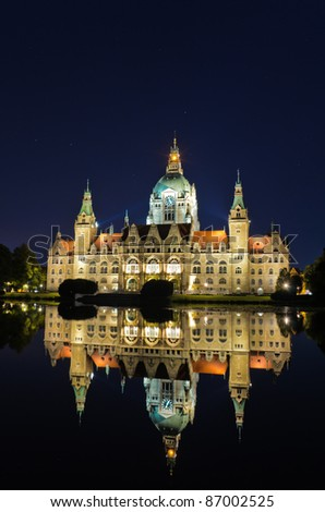 City Hall of Hannover, Germany by night with reflection in a lake - stock photo
