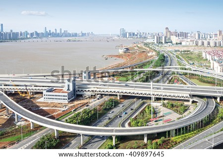 city highway interchange in shanghai on traffic rush hour #409897645