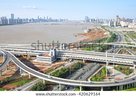 city highway interchange in shanghai on traffic rush hour #420629164