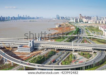 city highway interchange in shanghai on traffic rush hour #423992482