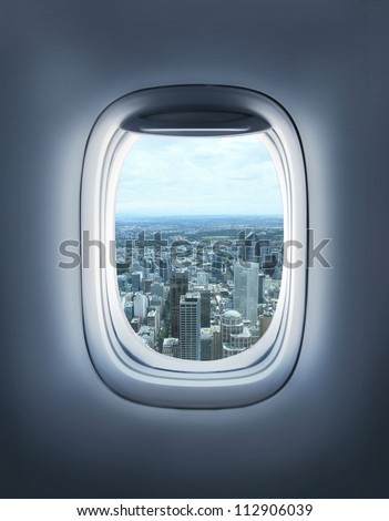 city in the aircraft's porthole