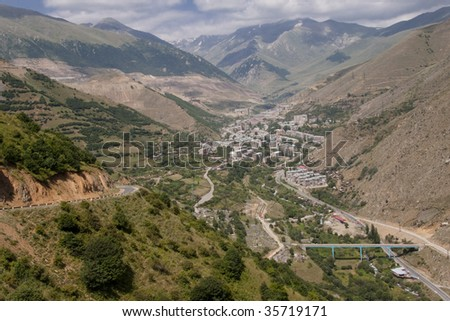 City in valley, aerial view on Kajaran in  Armenia. - stock photo