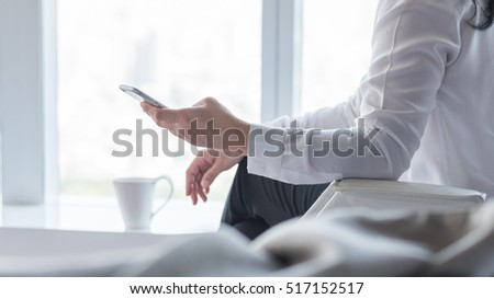 City lifestyle journalist blogger woman working on smartphone application texting in home office: Hand keyboard typing: People work wifi cyber IT IOT IM PPC communication technology daily life seo