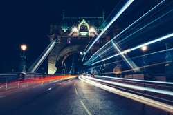 City light trails of traffic on Tower Bridge in London at night
