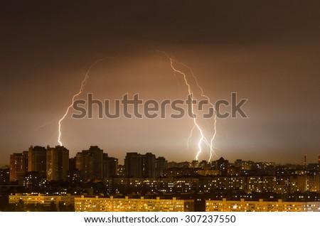 City lights night storm weather rain lightning
