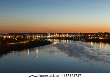 City lights of Great Falls, Montana over the Missouri River. #657593737