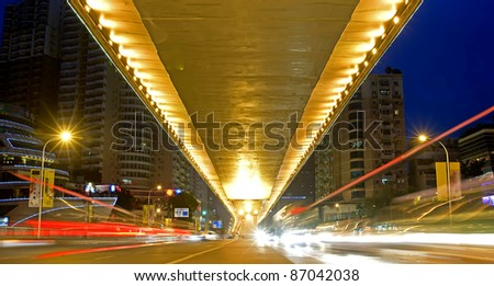 city night scene : flyover,light and hurtling car