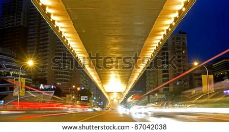 city night scene : flyover,light and hurtling car