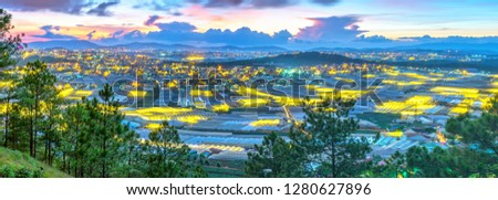 City night scene of a valley in Da Lat with greenhouses to plant flowers and vegetables. Blue hour moments when the sun sets it's time to light valley beauties adorn the romantic highland Vietnam