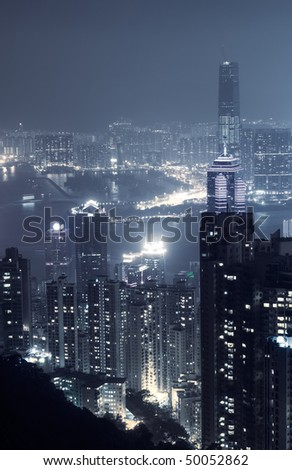 City night scene with modern skyscraper and buildings in Hong Kong, Asia. - stock photo