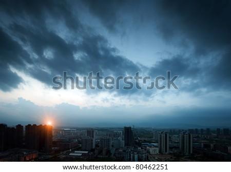 City night sky, a dark cloud.