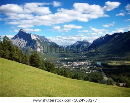 City of Banff in Alberta, Canada view from the top of the mountain to the valley below in the summer  #1024950277