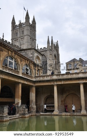 CITY OF BATH, ENGLAND - SEPTEMBER 7: Tourists at the ancient Roman Bath Museum in West England on Sept 7, 2011. The Baths are a major tourist attraction & receive more than 1 million visitors a year.