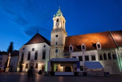 City of Bratislava in Slovakia, Town Hall and Jesuit Church by night in the Old Town