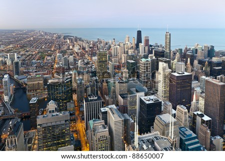 City of Chicago.  Aerial view  of Chicago downtown at twilight from high above.