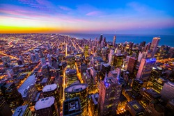 City of Chicago. Aerial view of Chicago downtown at twilight from high above. Cold colors toning.